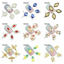 10 Pcs/Lot Pearl Butterfly Eagle Pineapple Charms Rhinestones Alloy Nails Tools For Glitter 3D Nail Art Decorations TN1327-1335(China)