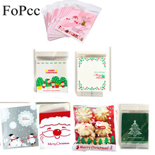 100Pcs Christmas Gift Bags Self-adhesive Plastic Cookies Packaging Bags Biscuits Snack Candy Cake Packing Bags Xmas Party Favors(China)