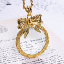 Classic Fashion Gift! Cute Bow shape Pendant Women Reading 2x Magnifying Glass Top Quality Necklace Reading Glass Pendant(China)