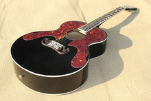 Best  acoustic guitar,solid black,rosewood bridge and fingerboard,star inlay ,with EQ with tortoise pickguard.Real photo shows