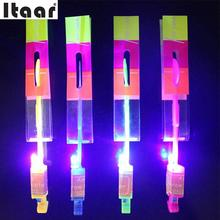 Funny Led Shining Spin Rocket Flash Arrow Helicopter Rubber Band Sling Shot Drop Shipping