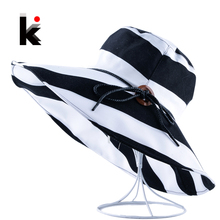 Women's Wide Brim UV Protection Beach Hats Stripe Bowknot Button Summer Sun Visor Caps For Women Floppy Bucket Chapeu Feminino(China)