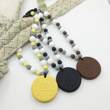 FREE SHIPPING! Silicone Baby Carrier Teether - Oreo like cookie teether - Hangs on Baby Carrier!