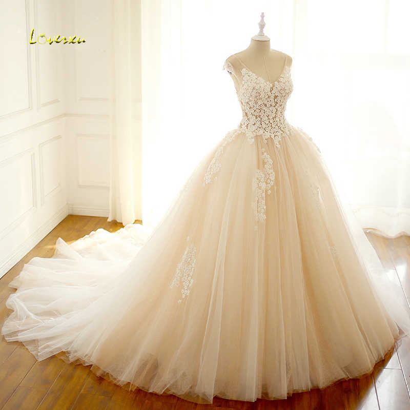 Loverxu Vestido De Noiva Sexy Illusion V Neck Flowers Wedding Dress 2019  Cap Sleeve Beaded Tulle 5ca713e3325f