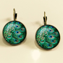 SUTEYI Fashion Crystal Earrings Unique Art Peacock Wiggling Feather Earring Jewelry Charm Animal Pattern Handmade Gift EF31(China)