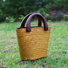 The new Thai version of the sea brocade package women's handbag retro fashion rattan grass package straw bag water bag