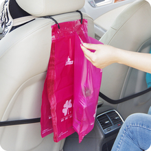 Creative used to paste 50pcs cars Storage Bag Hanging Breathable Plastic Garbage Bag Pouch Convenient Extraction Storage bags(China)