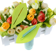 Cream Squeezer Home Tube Rolling Holder Squeezer 2PCS Leaves Shape Bathroom Tube Dispenser Toothpaste 3.5*8cm(China)