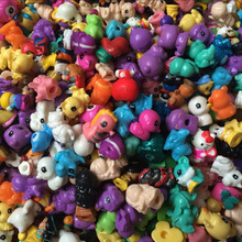 50 pcs/lot Squinkies Mini Twisted Egg Many Different Model Cartoon Doll Toy Capsule Toys Christams Gift(China)