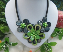 Black mother of pearl and green mop shell flower necklace on leather