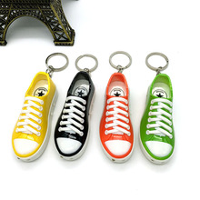 Fool 's Day new candy color electric shoes electric shock small shoes key pendant electric people whole toys shoes(China)