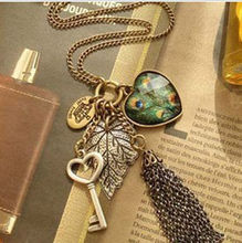 BONLAVIE 1 Piece Popular Retro Fashion Peacock Feathers Leaves Big Hearts Key Long Sweater Chain Tassel Pendant Necklace