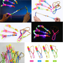 100Pcs/lot or 50pcs Amazing Light Arrow Rocket Helicopter Flying Toy LED Light Flash Toys Party Fun Gift Rubber Band Catapult(China)