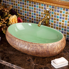 Porcelain bathroom ceramic counter top sink wash basin popular in europe art basin sanitary manufacture ceramic sink oval