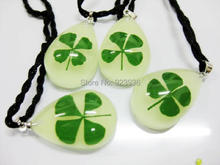 FREE SHIPPING 16pcs glow in dark drop bottom natural real four leaf clover fashion pendant St Parker cool gifts  GL01