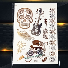 1PC HOT Gold Death Skull Guitar Temporary Tattoo Paste PCT-097 Angel Feather Wings Melody Guns Roses Punk Tattoo Stickers Women(China)