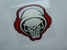 1pcs SKULL with earphone Reflectivemotocross stickers racing sticker for SBK motorcycle moto helmets decals car(China)