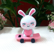 Free Shipping Rocking Under Full Light No Battery Creative Home Decoration Solar Powered Scooter Glasses Rabbit Toy Vehicle(China)