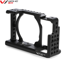 Buy DSLR Camera Video Cage Stabilizer Rig Sony A6000 / A6300 / NEX7 1/4 inch screw holes Stabilizer Handle for $32.99 in AliExpress store