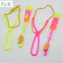 50Pcs or 100pcs Amazing LED Light Arrow Rocket Helicopter rotating Flying Toy Party Fun Gift Blue light(China)