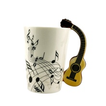 Newest Creative Novelty Guitar Ceramic Cup Personality Music Note Sensitive Mug Cup Coffee Tea Milk Cup Unique Gift Home Cafe(China)