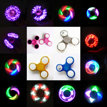2017 New Hot Fidget spinner 8-color Glow in the dark Fashion Hand spinner lights LED Cool stickers toys Gift spinner Finger Gyro