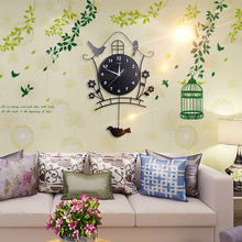 The modern European style decorative luminous personality fashion creative living room wall clock swing mute bedroom home bird W(China)