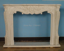 carved stone fireplace mantel European Baroque style living room fireplace