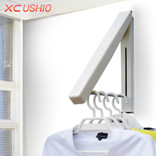 Stainless Steel Wall Hanger Retractable Indoor Clothes Hanger Magic Foldable Drying Rack Waterproof Clothes Towel Rack(China)