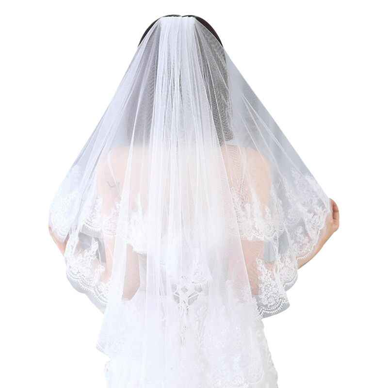 Beautiful soft tulle wedding veil with daisy trim.