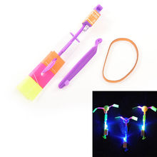 HOT 1 Pcs funny Shining Rocket Flash Copter Arrow Helicopter Neon Led Light Amazing Elastic Powered LED Arrow Helicopter(China)