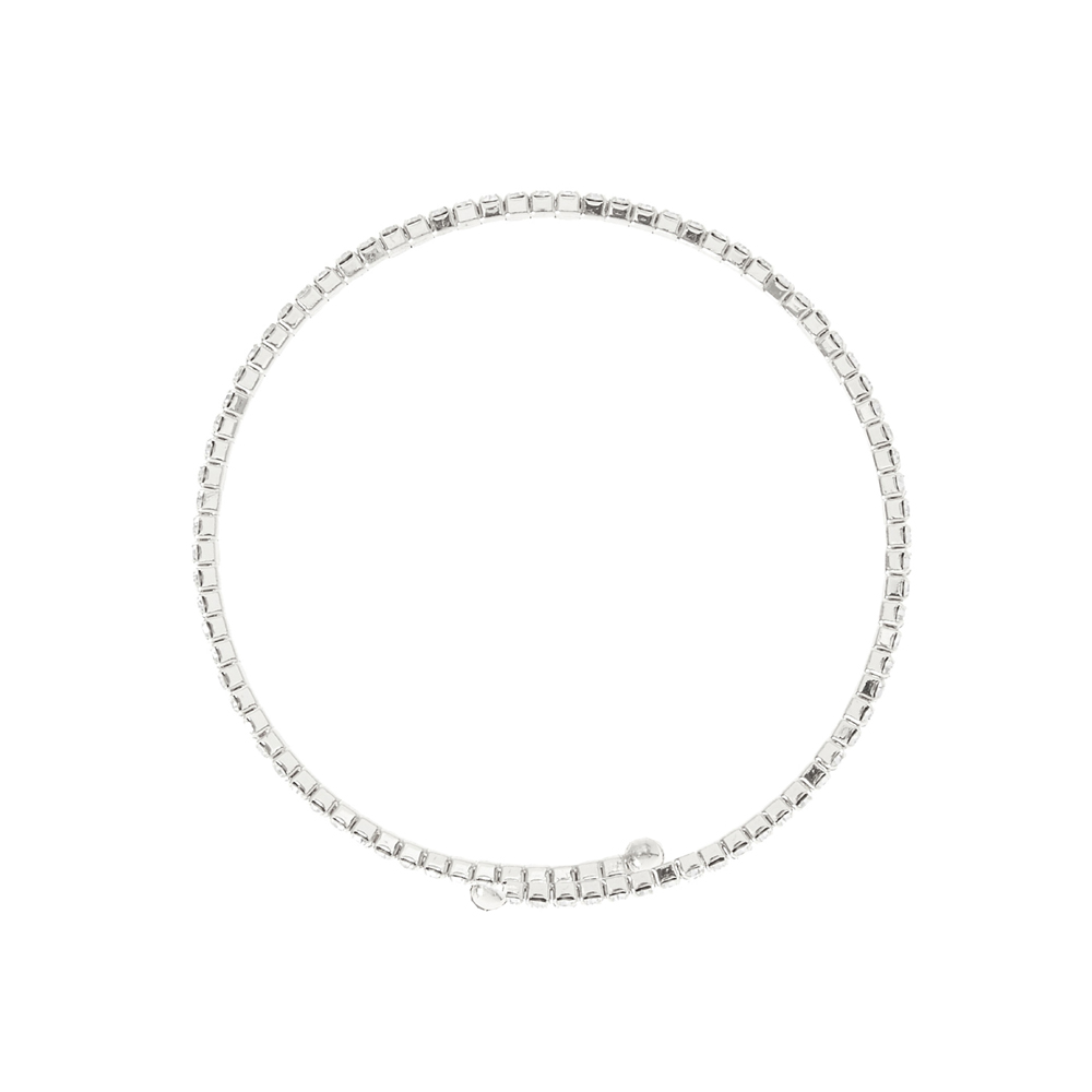 This dainty bracelet will make your wrist sparkle. Thin silver band is accented with pave rhinestones and coils around your wrist