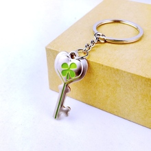 2016 new fashion sliver plated lucky green key shape clover key chain ring keychain women men novelty items creative charm gift(China)