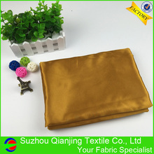 Factory wholesale 100% polyester high quality shiny gold silk satin fabric