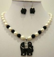 White pearl purple  jade  black agate elephant pendant necklace earring set