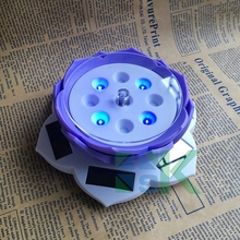 1pcs/lot Creative Fashion white purple LED light solar power rotating display stands for home decoravtive souvenir holder rack