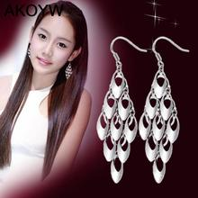 Silver Colour peacock tail tassel earrings long section of high-quality fashion cute lady jewelry manufacturers, wholesale