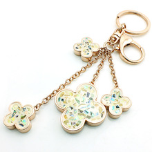JINGLANG Brand New Fashion Gold Color Lobster Clasp Key Rings Dangle Clover Charms Women keychain Handbag Luxury Jewelry