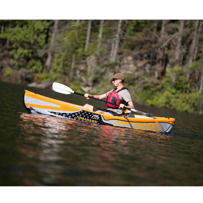 Big white kayak with paddle