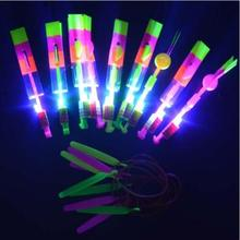 200pcs Luminous Big Slingshot Catapult Arrows Flying Fairies Flash Helicopter Flying LED Light Emitting Children's Toys DHL(China)