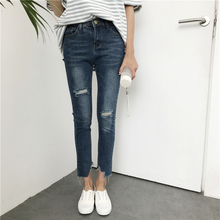 In the spring of 2017 new Korean all-match ripped hole gap irregular jeans pants female tide