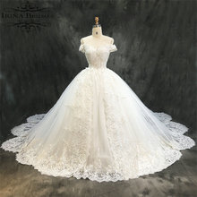 Real Sample Short Sleeve Lace Appliqued Crystal Beads Flowers Irregular Tail Wedding Dress 2018(China)