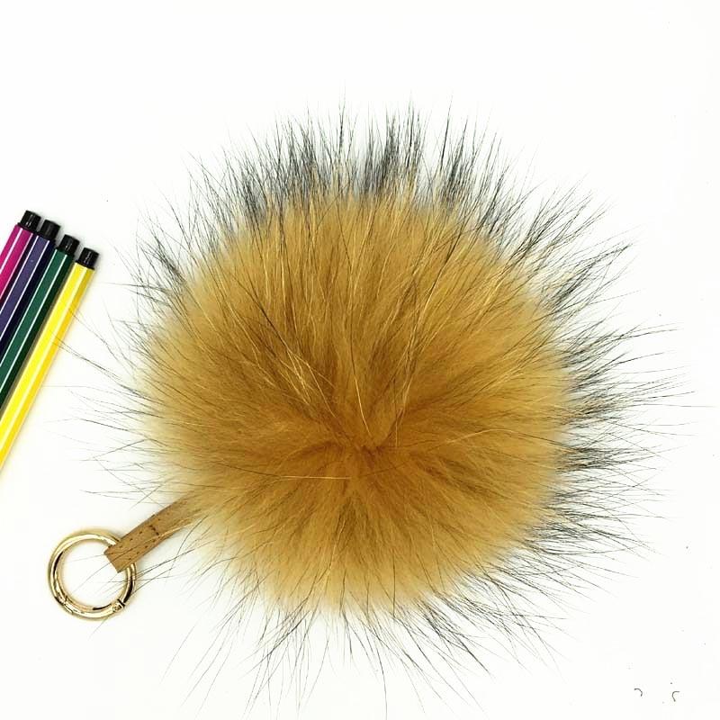 raccoon fur pompom gold 1
