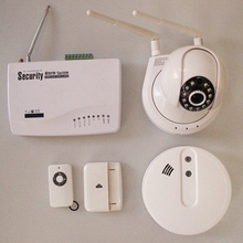 1set security telephone network alarm host with 1 pcs IP camera ,1 pcs fire smoking and gas detector(China)