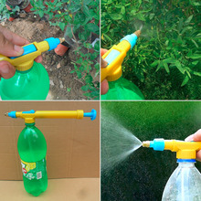 2016 New Mini Bottles of Juice Interface Plastic Trolley Squirt Gun Sprayer Head Water Pressure Hot Search Free Shipping