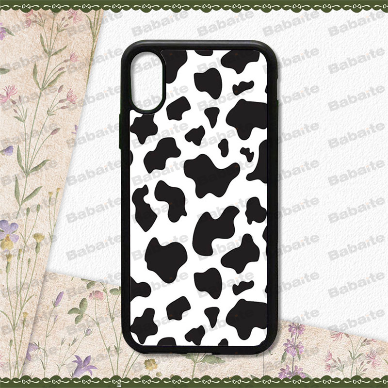 Checkered grid black and white cow