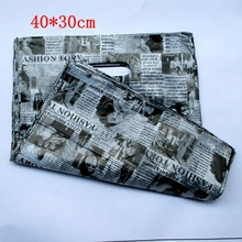wholesale Free Shipping 100pcs/lot English newspaper Gift Bags Plastic Boutique Pouches Shopping Gift Package Bag 40*30cm154021(China)