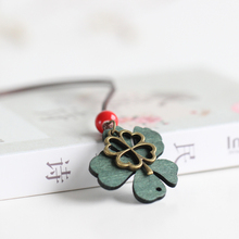 Characteristics of original national wind accompanied by four leaf necklace fashion ceramic small adorn article LX3114