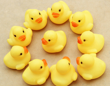 EMS Free shipping 2000pcs/lot Wholesale 4.2*4*3.5cm Mini Yellow Hong Kong Rubber duck Pvc bath toy sound Floating Duck(China)
