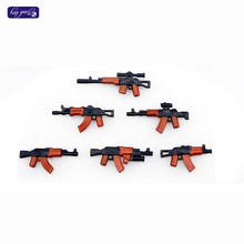 HAOGAOLE 6pcs Baby Toys Beret UN Bulletproof AK guns Weapons Pack Military Series Army Bricks Arms For City Police Blocks Toys